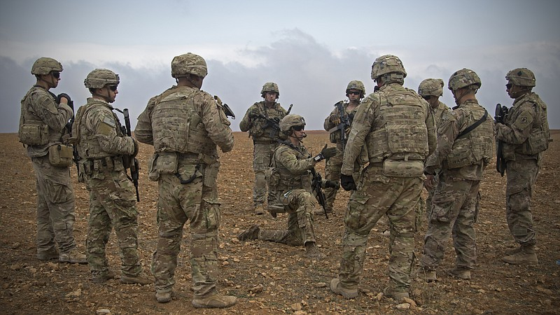 U.S. soldiers gather for a brief during a combined joint patrol rehearsal in ...