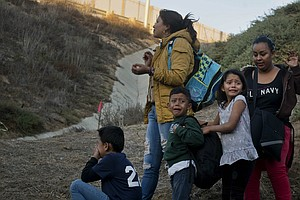 Migrant Families Arrive In Busloads As Border Crossings H...