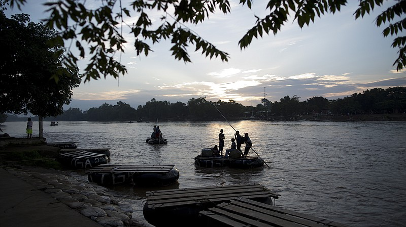 Passengers from Tecun Uman, Guatemala (across the water), arrive by raft at C...
