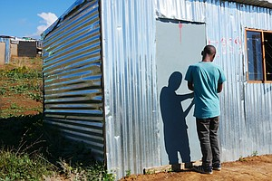 Hopeful Squatters, Angry Owners, A Murder: South Africa's...
