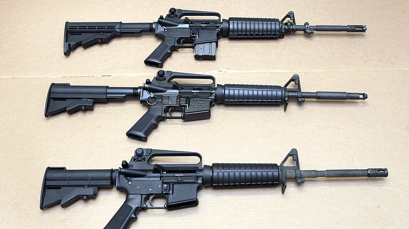 Three variations of the AR-15 rifle are displayed at the California Departmen...