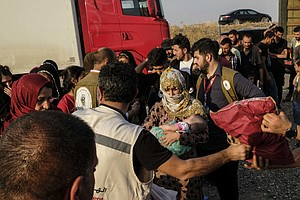 'We Didn't Believe We Would See The Sun Rise': Refugees From Syria Arrive In ...