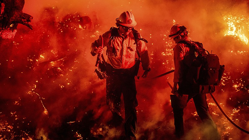 Firefighters battle the Maria Fire in California's Ventura County. The blaze ...