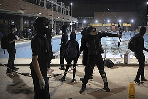 Hong Kong Police Say Protesters Are Shooting Arrows From ...