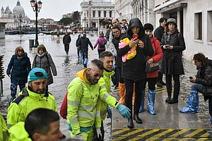After Venice Floods, Volunteers Wade In To Help Salvage W...