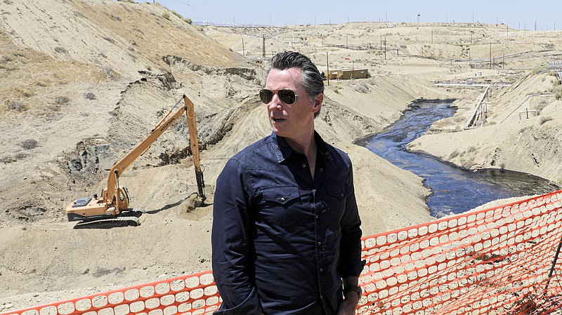 Gov. Gavin Newsom tours the Chevron oil field west of Bakersfield, where a sp...