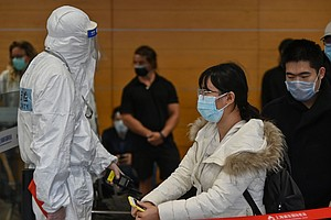 Health Checks Await Travelers Entering China, As It Tries To Block COVID-19 R...