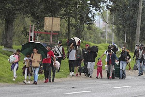 Thousands Of Migrants Head Back To Venezuela To Flee Colombia's COVID-19 Lock...