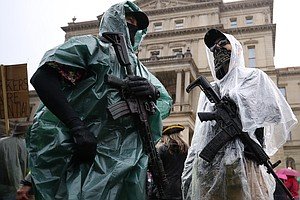 Heavily Armed Protesters Gather Again At Michigan Capitol To Decry Stay-At-Ho...