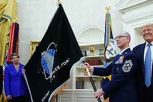 Trump, Unveiling Space Force Flag, Touts What He Calls New 'Super-Duper Missile'