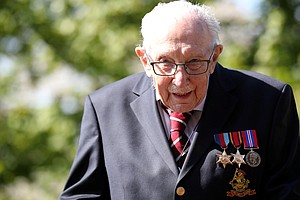 Tom Moore, U.K.'s 100-Year-Old Hero, Is Awarded Knighthood For Fundraising Walks