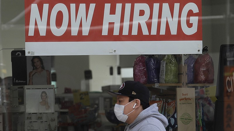 A walks by a CVS Pharmacy in San Francisco on May 7. U.S. employers unexpecte...