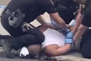 Police Investigate Incident Where Officer Appeared To Use Knee To Restrain Su...