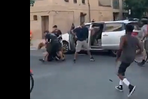 New York Police Draw Anger After Plainclothes Officers Throw Woman Into Unmar...