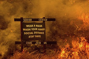 Wildfires Rage On In California As Fire Crews And Evacuees Grapple With COVID...