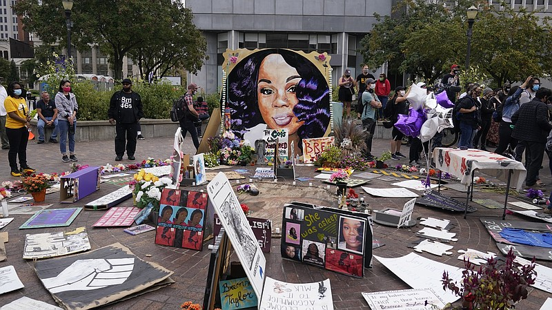 In this Wednesday, Sept. 23, 2020, people gather in Jefferson Square in Louis...