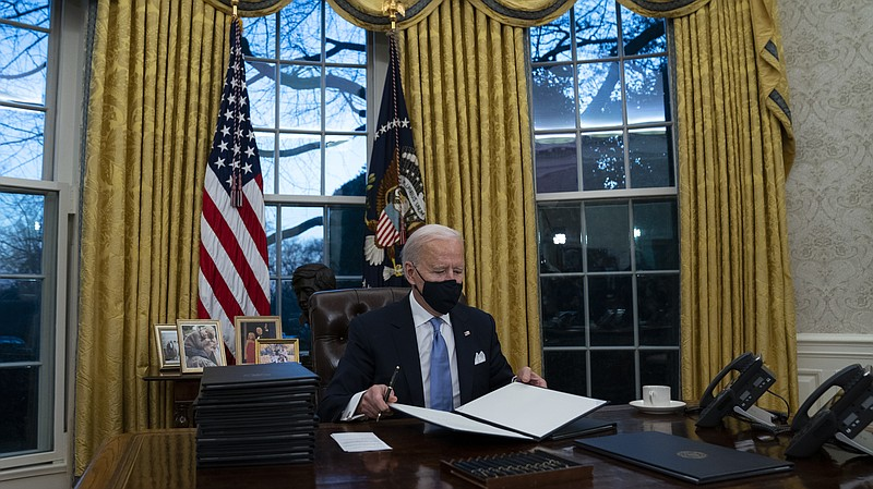 In this Jan. 20, 2021, file photo President Joe Biden signs a series of execu...