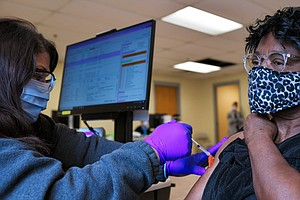 Addressing Racial Divides In Health Care Seen As Key To Boosting Black Vaccin...