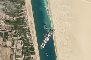 Photo for Giant Container Ship That Blocked Suez Canal Set Free
