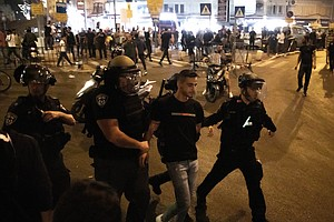 Clashes Between Palestinians, Israeli Police In Jerusalem Leave Many Injured