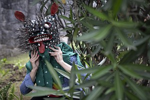 PHOTOS: Mexican Artists Create Fantastical Masks To Show The Many Faces Of COVID