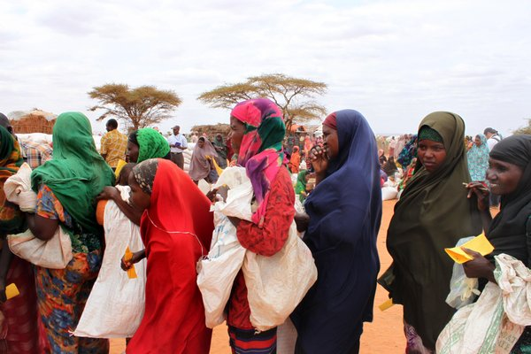 Women wait in line at a food distribution site in Dolo, Somalia, where the U.N. has declared some 2.5 million people are in crisis from famine, July 2012.