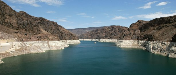 The white 'bathtub ring' on the rocks along the Colorado River is from mineral deposits left by higher levels of water.