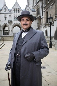 Detective Hercule Poirot from Agatha Christie mysteries.