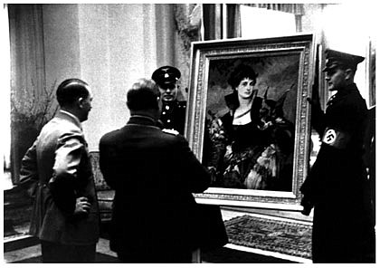 Adolf Hitler presents Hermann Goering with The Falconer (1880), a painting by...