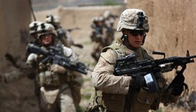 U.S. Marine machine gunner LCpl. Daniel Wescovich (R), patrols with his squad in Now Zad in Helmand province, Afghanistan -- a battleground between Taliban fighters and Marines from the 3rd Battalion, 8th Marine Regiment.