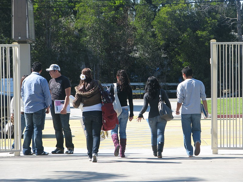 Teens head out after class at a San Diego County high school.