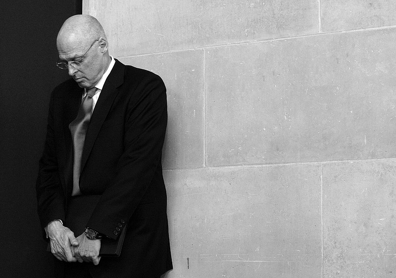 Secretary of Treasury Henry Paulson waits offstage prior to delivering an add...