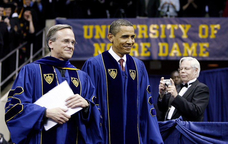 U.S. President Barack Obama and University President Rev. John I. Jenkins (L)...