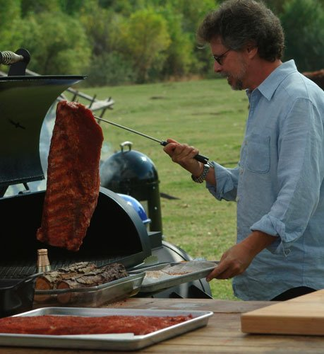 Steven Raichlen, host of Primal Grill, preparing ribs.