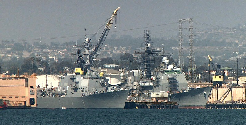 Two Navy ships docked in the San Diego Bay.