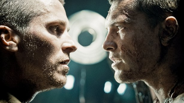 Christian Bale as John Connor and Sam Worthington as Marcus Wright face off in Terminator Salvation