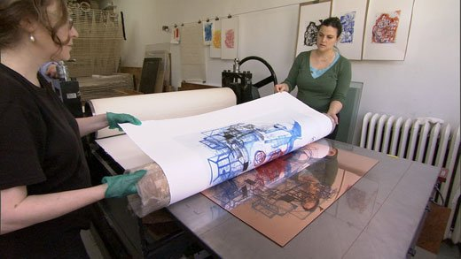 Artists working in a print shop.