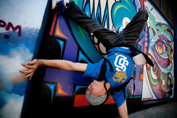 Culture Shock B-Boy David Silvas breakdances in front of mural located at 9th...