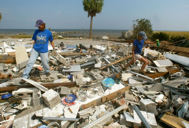 Mary Anne Schmitz (R) and Kay Hoffman (L) look for items in the rubble where ...
