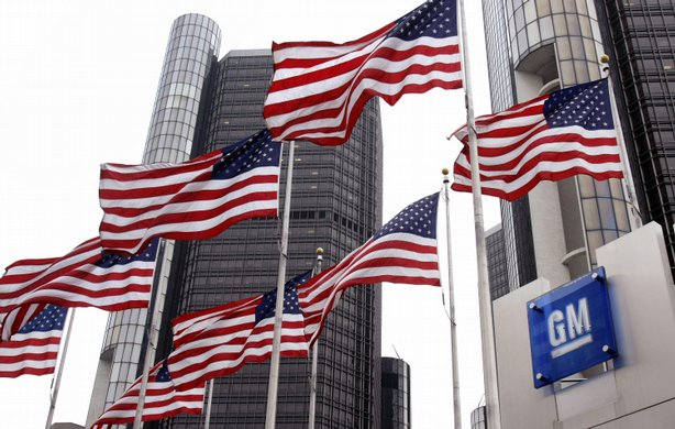 Flags fly outside the General Motors world headquarters building May 27, 2009...