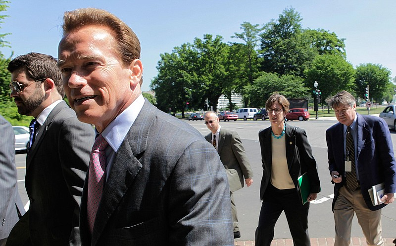 California Gov. Arnold Schwarzenegger walks near the U.S. Capitol on May 20, ...