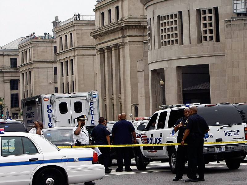Police gather in front of the Holocaust Museum following a shooting at the mu...