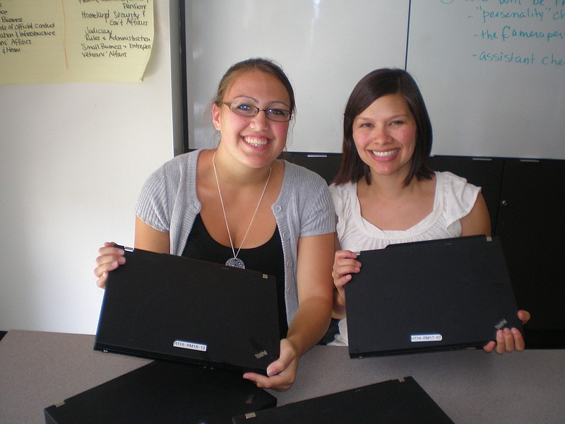 High Tech High math teacher Nicole Pack (right) and her student display two o...