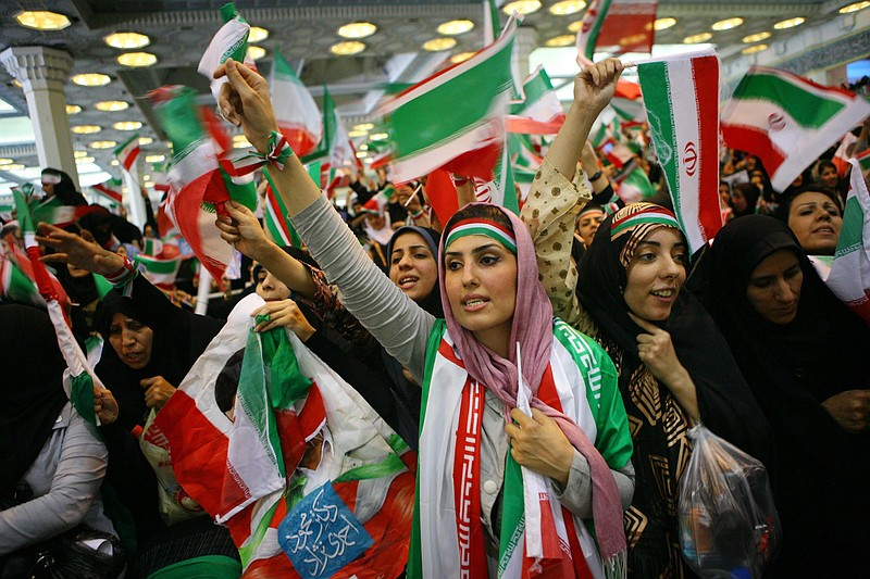 Iranian women attend an electoral campaign rally in support of incumbent Pres...
