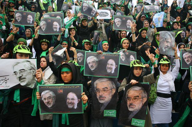 Supporters of presidential candidate for Iran, Mir Hossein Mousavi, gather du...
