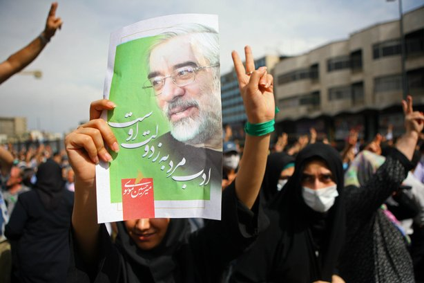 Iranian supporters of defeated reformist presidential candidate Mir Hossein M...