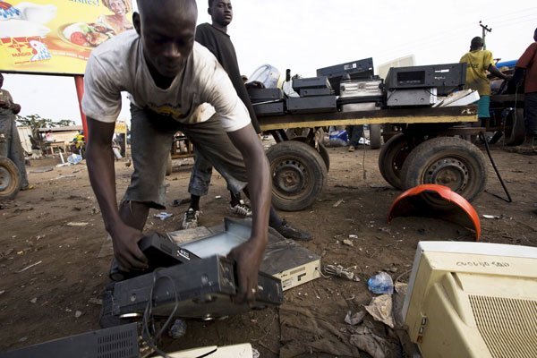 <em>FRONTLINE/World</em> presents a global investigation into the dirty secret of the digital age — the dumping of hundreds of millions of pounds of electronic waste around the world each year. Pictured: In Ghana, a man sorts through electronics to be sold for parts.