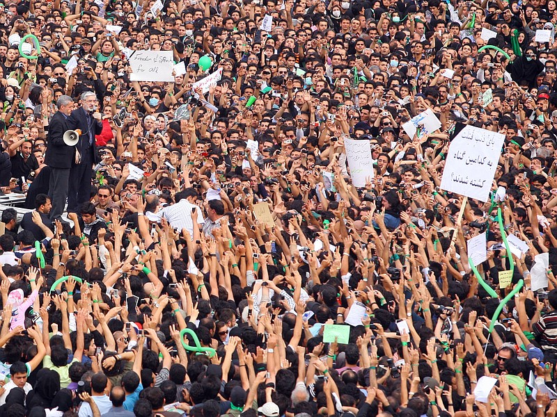 Defeated reformist presidential candidate Mir Hossein Mousavi speaks to the c...