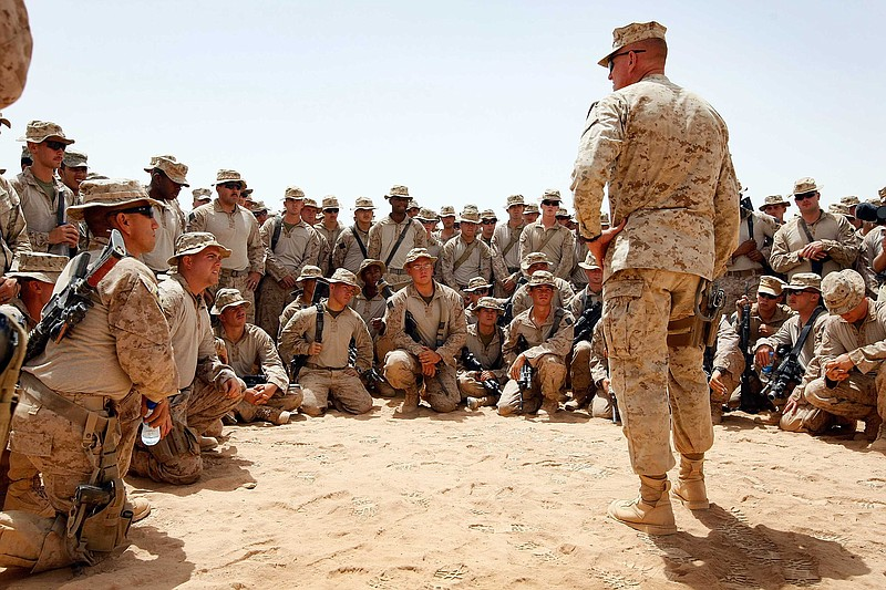 U.S. Lt. Col. Christian Cabaniss speaks to his Marines at Camp Dwyer on July ...