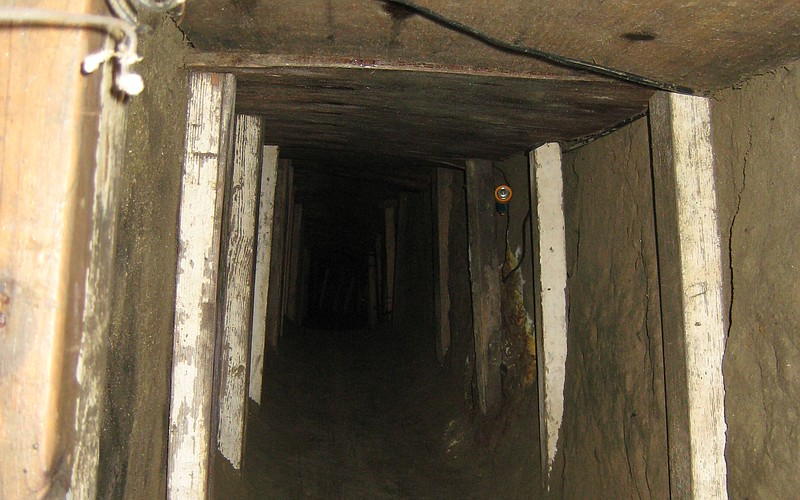 A 50 foot section of the tunnel has wood supports and a roof.